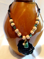 The large pendant is dark green jade...